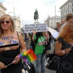 Inspired by the Ukrainian topless activist group, FEMEN, one protester had painted the words 'No Putin' on her chest.Photo: Kim Traill
