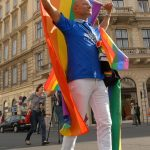 One of the parade organisers - from the local AIDS Hilfe Wien association - leads the parade towards the State Opera.Photo: Kim Traill