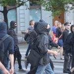 Many of the protestors wore masks and hoods, possibly to prevent identification.Photo: Paul Gillingwater