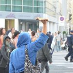 One protestor wielded a piece of pizza, which she threw at police.  The protestors named their squat after the fact that the building from which they were evicted used to house a pizzeria.Photo: Paul Gillingwater