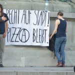A banner suggested that these protestors were strongly supporting the pizzeria anarchist group who were evicted in Monday's raid.Photo: Paul Gillingwater