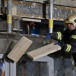 Third building evacuated as collapse feared