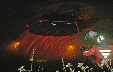 Out of control Ferrari lands in pond
