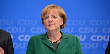 Cracks in Merkel coalition after spy claims