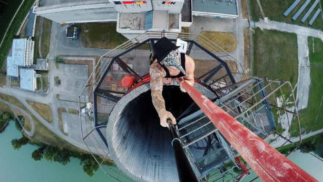 Roofers scale nuclear plant chimney stack