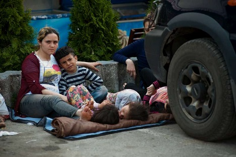 Germany eases rules as refugee crisis intensifies