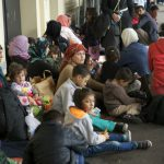 Women and children sit on the ground on platform 1 at Westbahnhof. Many of the youngest children are sick.Photo: Kim Traill