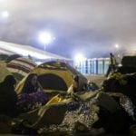 Tensions mount as refugees wait in cold