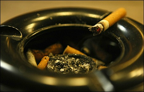 Policeman compensated in passive smoking case