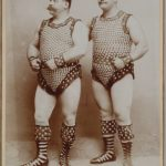 Two muscular men show off their studded outfits.Photo: Wien Museum