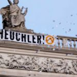 Austrian extremists scale theatre roof in latest protest