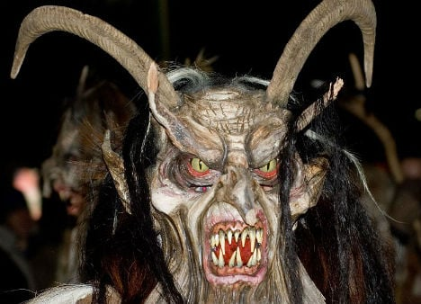 Krampus bursts into flames after procession