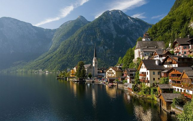 Bouncers guard Hallstatt's church doors during services to keep tourists away