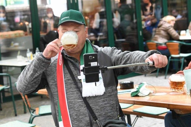 IN PICTURES: Austria celebrates in beer gardens after six-month lockdown ends