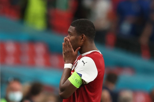 Austria's defender David Alaba reacts after their defeat in UEFA EURO 2020 (Photo by Catherine Ivill / POOL / AFP)