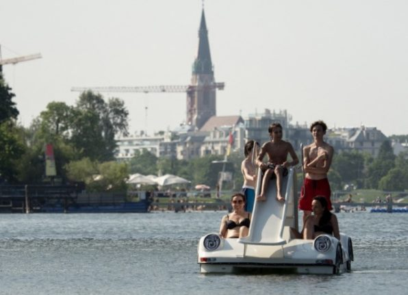 People make their way in pedal boats on the Old Danube (Alte Donau), in Vienna, Austria. (Photo by JOE KLAMAR / AFP)